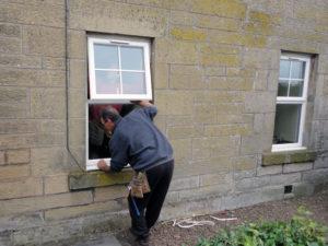 man replacing window