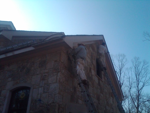 painting trim on stone exterior